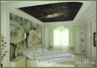 un cabecero de cama creado con un mural de pared
