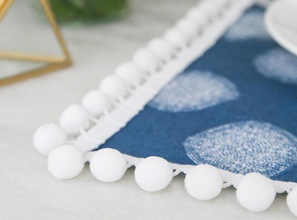 Decorar servilletas con pompones